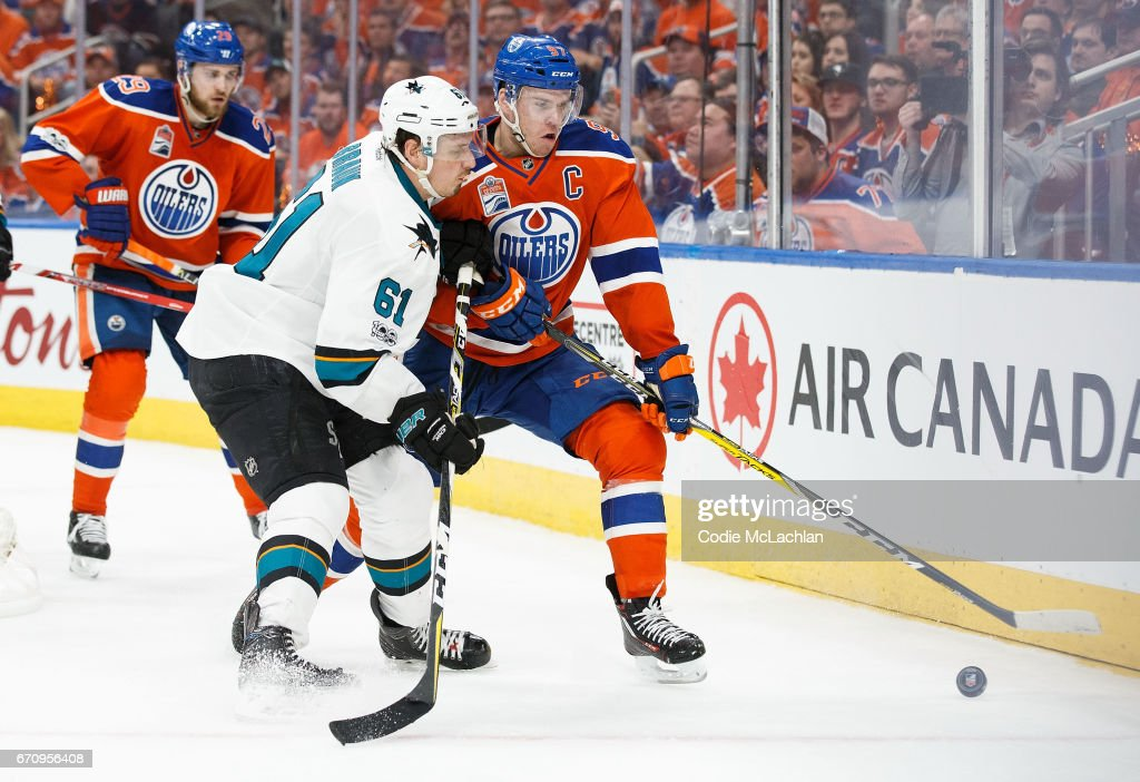 Connor McDavid #97 of the Edmonton Oilers battles against Justin Braun #61 of the San Jose Sharks in Game Five of the Western Conference First Round during the 2017 NHL Stanley Cup Playoffs at Rogers Place on April 20, 2017 in Edmonton, Alberta, Canada.