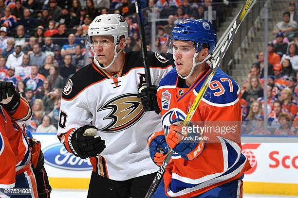 Connor McDavid of the Edmonton Oilers battles for position against Corey Perry of the Anaheim Ducks on December 3 2016 at Rogers Place in Edmonton...