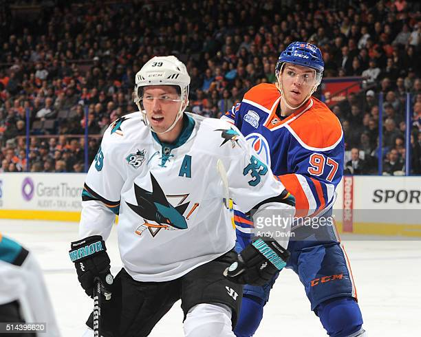 Connor McDavid of the Edmonton Oilers battles for the puck against Logan Couture of the San Jose Sharks on March 8 2016 at Rexall Place in Edmonton...