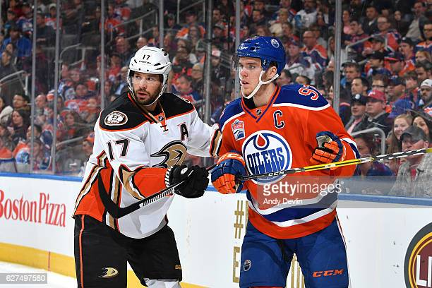 Connor McDavid of the Edmonton Oilers battles for the puck against Ryan Kesler of the Anaheim Ducks on December 3 2016 at Rogers Place in Edmonton...