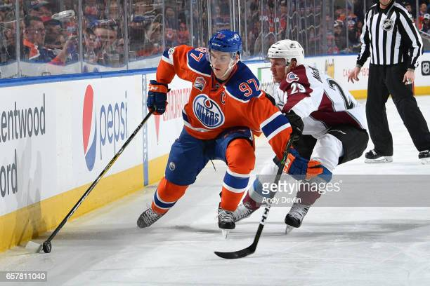 Connor McDavid of the Edmonton Oilers battles for the puck against Nathan MacKinnon of the Colorado Avalanche on March 25 2017 at Rogers Place in...