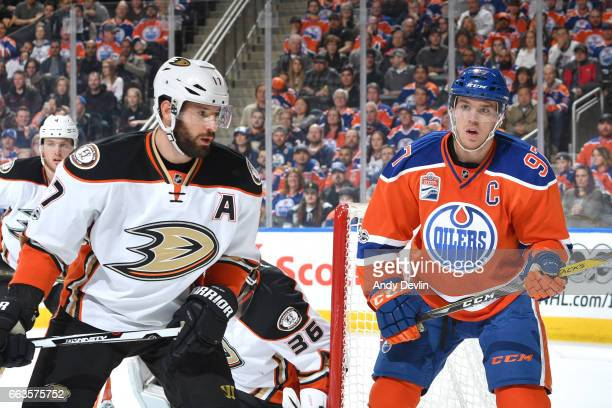 Connor McDavid of the Edmonton Oilers battles for the puck against Ryan Kesler of the Anaheim Ducks on April 1 2017 at Rogers Place in Edmonton...