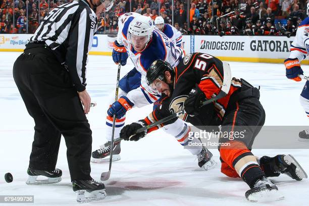 Connor McDavid of the Edmonton Oilers battles in a faceoff against Antoine Vermette of the Anaheim Ducks in Game Five of the Western Conference...