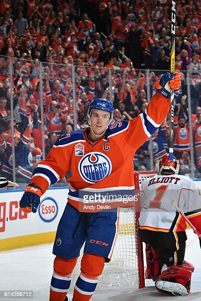 Connor McDavid of the Edmonton Oilers celebrates after scoring a goal during the season opener against the Calgary Flames on October 12 2016 at...