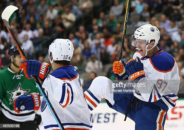 Connor McDavid of the Edmonton Oilers celebrates his first career NHL goal against the Dallas Stars in the second period at American Airlines Center...