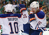 Connor McDavid of the Edmonton Oilers celebrates his first career NHL goal with Nail Yakupov against the Dallas Stars in the second period at...