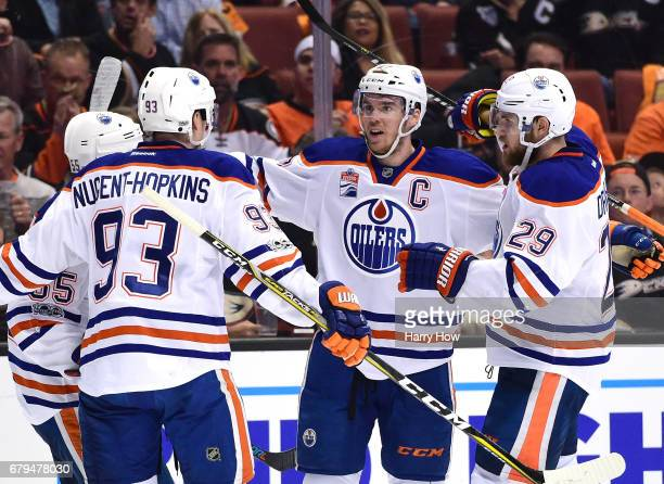 Connor McDavid of the Edmonton Oilers celebrates his power play goal with Mark Letestu Ryan NugentHopkins and Leon Draisaitl to take a 20 lead over...