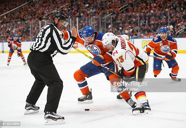 Connor McDavid of the Edmonton Oilers faces off against Sean Monahan of the Calgary Flames on October 12 2016 at Rogers Place in Edmonton Alberta...