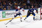 Connor McDavid of the Edmonton Oilers handles the puck as Jay Bouwmeester of the St Louis Blues defends on October 8 2015 at Scottrade Center in St...