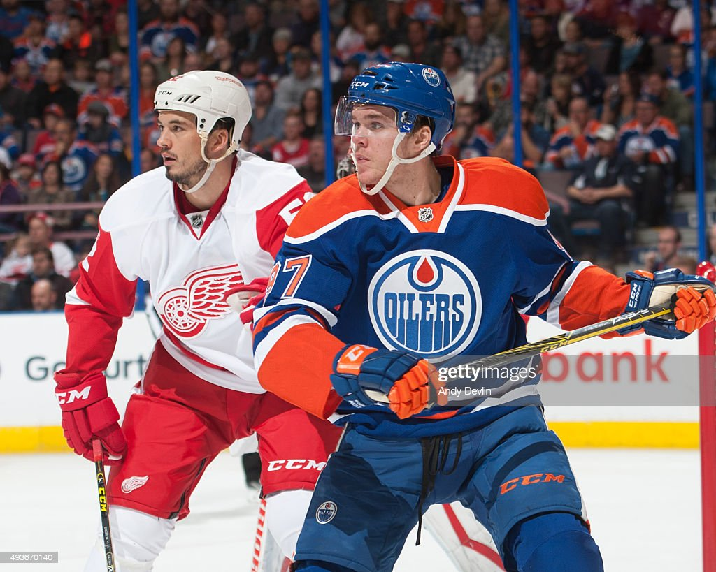 Connor McDavid of the Edmonton Oilers in action with Jonathan Ericsson of the Detroit Red Wings on October 21 2015 at Rexall Place in Edmonton...