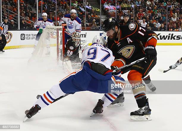 Connor McDavid of the Edmonton Oilers is checked by Ryan Kesler of the Anaheim Ducks during the second period at the Honda Center on January 25 2017...