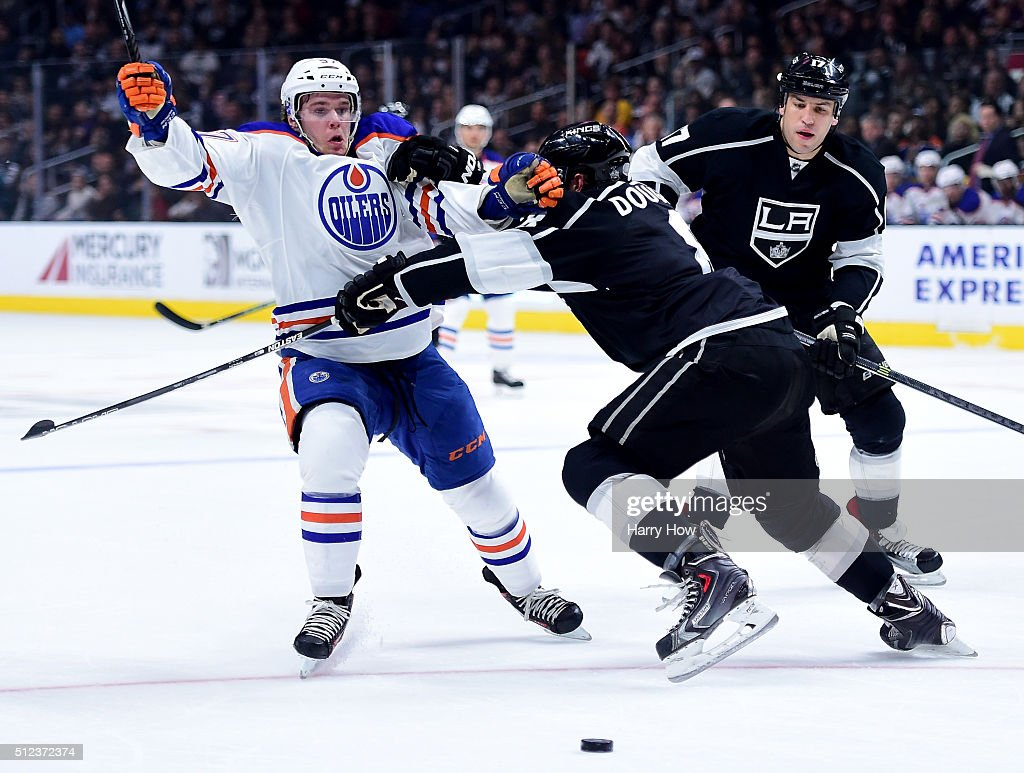 <a gi-track='captionPersonalityLinkClicked' href=/galleries/search?phrase=Connor+McDavid&family=editorial&specificpeople=9756794 ng-click='$event.stopPropagation()'>Connor McDavid</a> #97 of the Edmonton Oilers is knocked off balance by <a gi-track='captionPersonalityLinkClicked' href=/galleries/search?phrase=Drew+Doughty&family=editorial&specificpeople=2085761 ng-click='$event.stopPropagation()'>Drew Doughty</a> #8 of the Los Angeles Kings during the first period at Staples Center on February 25, 2016 in Los Angeles, California.