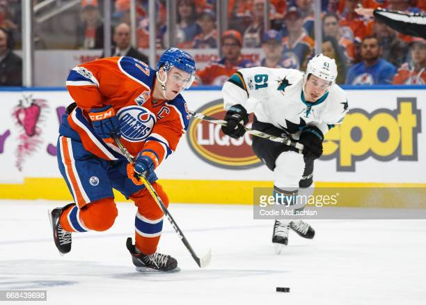 Connor McDavid of the Edmonton Oilers is pursued by Justin Braun of the San Jose Sharks in Game One of the Western Conference First Round during the...