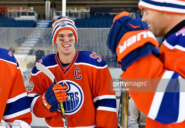 Connor McDavid of the Edmonton Oilers jokes around during practice in advance of the 2016 Tim Hortons NHL Heritage Classic game at Investors Group...