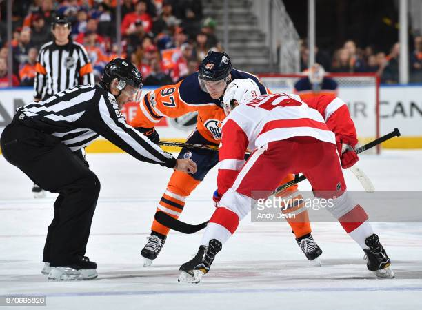 Connor McDavid of the Edmonton Oilers lines up for a face off against Frans Nielsen of the Detroit Red Wings on November 5 2017 at Rogers Place in...