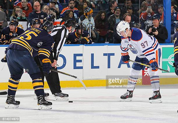 Connor McDavid of the Edmonton Oilers prepares for a faceoff against Jack Eichel of the Buffalo Sabres during an NHL game on March 1 2016 at the...