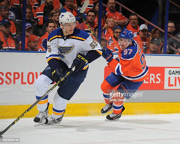 Connor McDavid of the Edmonton Oilers pursues Colton Parayko of the St Louis Blues on October 15 2015 at Rexall Place in Edmonton Alberta Canada