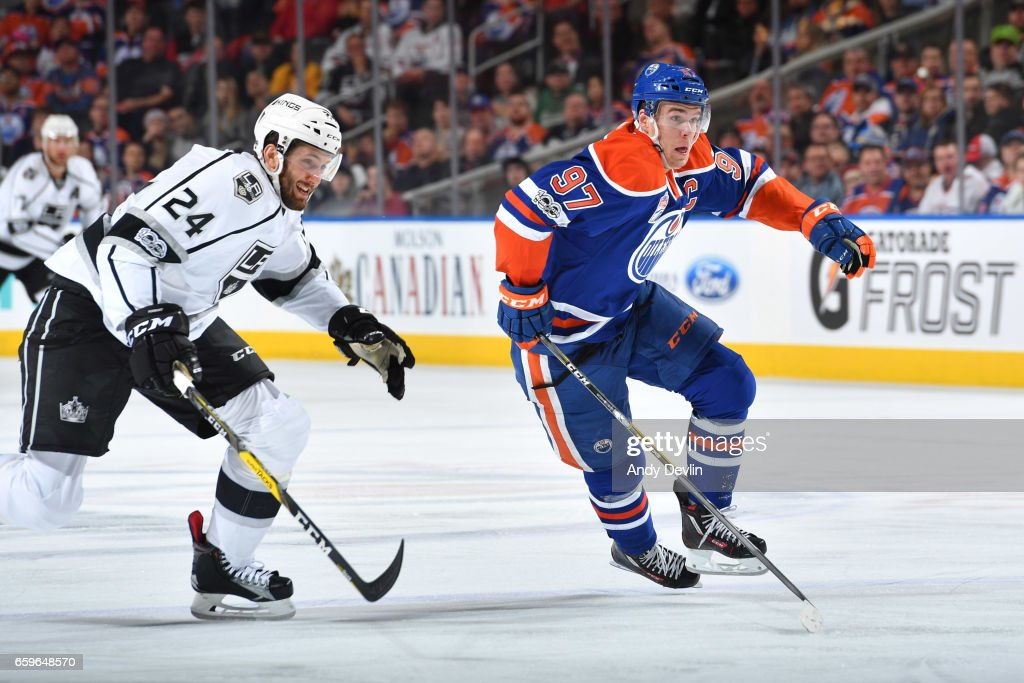 Connor McDavid #97 of the Edmonton Oilers races for the puck with Derek Forbort #24 of the Los Angeles Kings on March 28, 2017 at Rogers Place in Edmonton, Alberta, Canada.