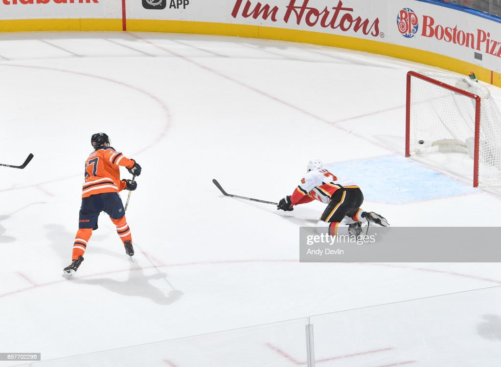 Connor McDavid #97 of the Edmonton Oilers scores his third goal of the game during the game against the Calgary Flames on October 4, 2017 at Rogers Place in Edmonton, Alberta, Canada.