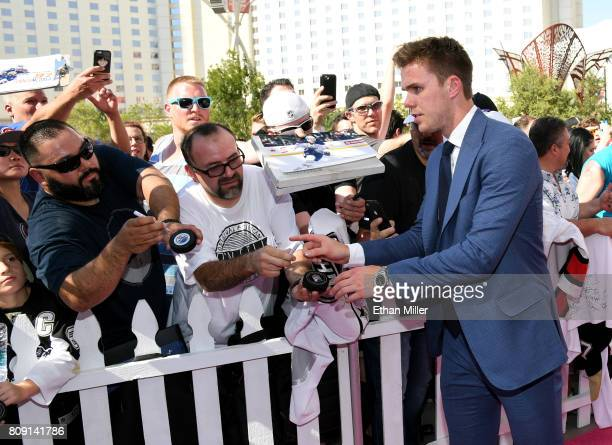 Connor McDavid of the Edmonton Oilers signs autographs for fans as he attends the 2017 NHL Awards at TMobile Arena on June 21 2017 in Las Vegas Nevada