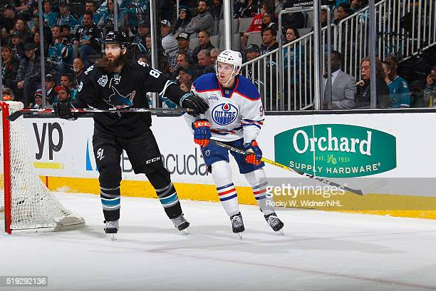 Connor McDavid of the Edmonton Oilers skates against Brent Burns of the San Jose Sharks at SAP Center on March 24 2016 in San Jose California