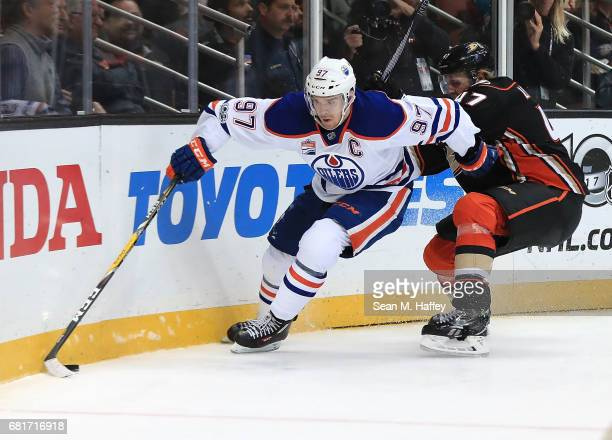 Connor McDavid of the Edmonton Oilers skates against Hampus Lindholm of the Anaheim Ducks in Game Seven of the Western Conference Second Round during...