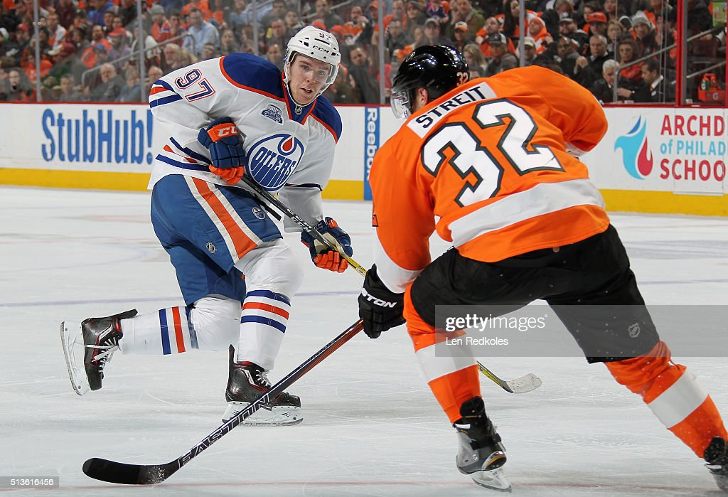 Connor McDavid #97 of the Edmonton Oilers skates against Mark Streit #32 of the Philadelphia Flyers on March 3, 2016 at the Wells Fargo Center in Philadelphia, Pennsylvania. The Oilers went on to defeat the Flyers 4-0.