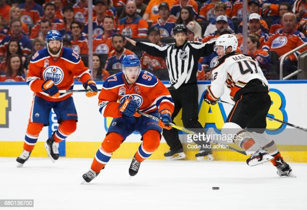 Connor McDavid of the Edmonton Oilers skates the puck against the Anaheim Ducks wheels in Game Six of the Western Conference Second Round during the...