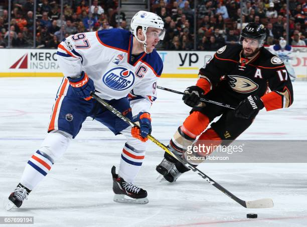 Connor McDavid of the Edmonton Oilers skates with the puck against Ryan Kesler of the Anaheim Ducks during the game on March 22 2017 at Honda Center...