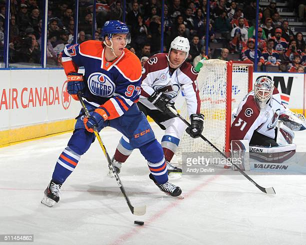 Connor McDavid of the Edmonton Oilers skates with the puck while being pursued by Francois Beauchemin of the Colorado Avalanche on February 20 2016...