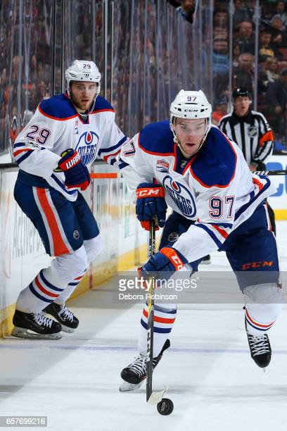 Connor McDavid of the Edmonton Oilers skates with the puck with help from Leon Draisaitl during the game against the Anaheim Ducks on March 22 2017...