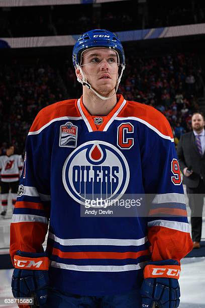 Connor McDavid of the Edmonton Oilers stands for the singing of the national anthem prior to the game against the New Jersey Devils on January 12...
