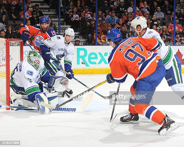 Connor McDavid of the Edmonton Oilers takes a shot on Jacob Markstrom of the Vancouver Canucks on March 18 2016 at Rexall Place in Edmonton Alberta...