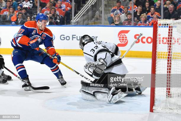 Connor McDavid of the Edmonton Oilers takes a shot on Jonathan Quick of the Los Angeles Kings on March 20 2017 at Rogers Place in Edmonton Alberta...