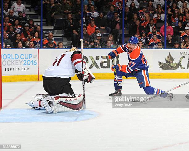 Connor McDavid of the Edmonton Oilers takes a shot on Mike Smith of the Arizona Coyotes on March 12 2016 at Rexall Place in Edmonton Alberta Canada