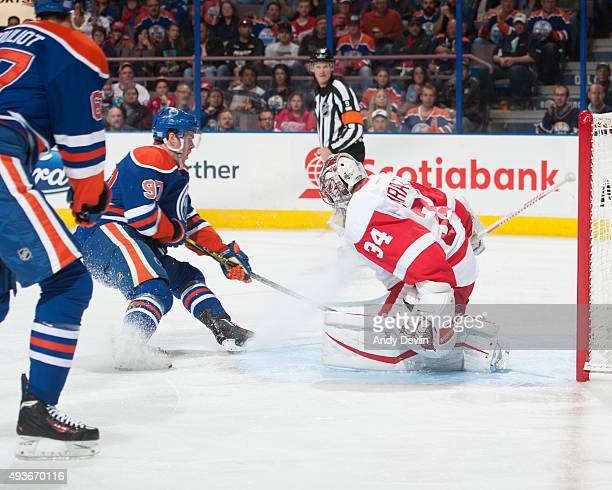 Connor McDavid of the Edmonton Oilers takes a shot on Petr Mrazek of the Detroit Red Wings during a game against the Detroit Red Wings on October 21...
