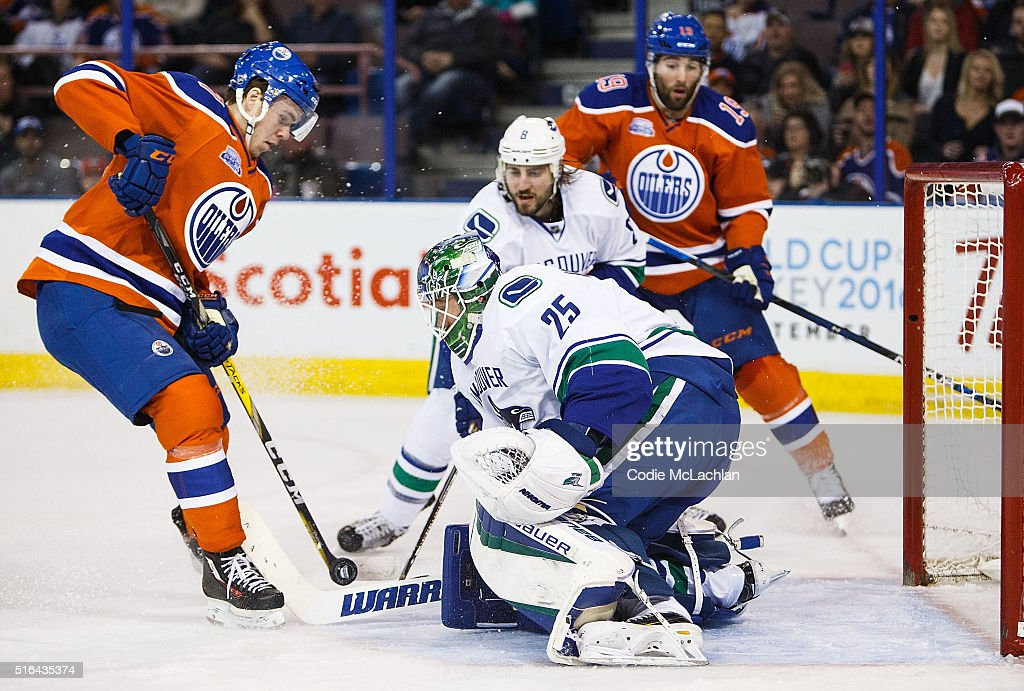 Connor McDavid of the Edmonton Oilers tries to put a shot past goaltender Jacob Markstrom of the Vancouver Canucks on March 18 2016 at Rexall Place...