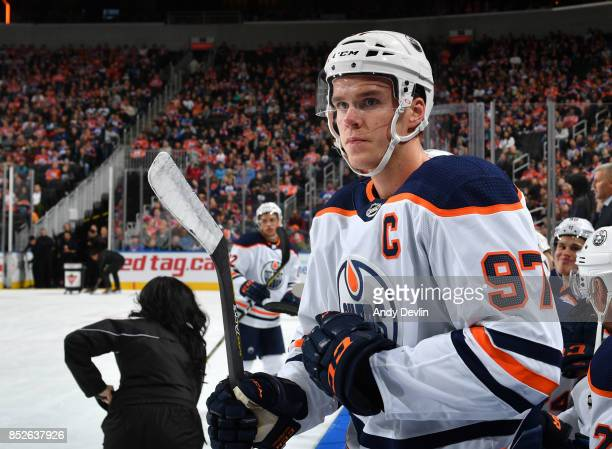 Connor McDavid of the Edmonton Oilers watches from the bench during the preseason game against the Winnipeg Jets on September 23 2017 at Rogers Place...