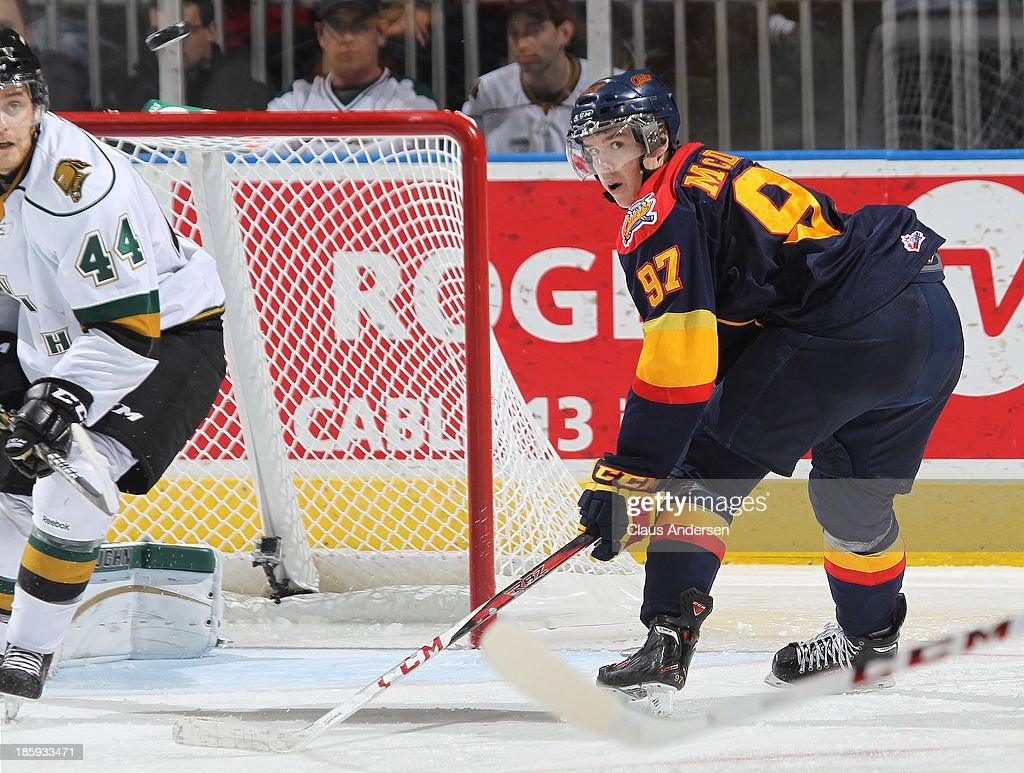 Connor McDavid #97 of the Erie Otters keeps an eye on a puck against the London Knights during an OHL game at the Budweiser Gardens on October 25, 2013 in London, Ontario, Canada. The Otters defeated the Knights 5-1.