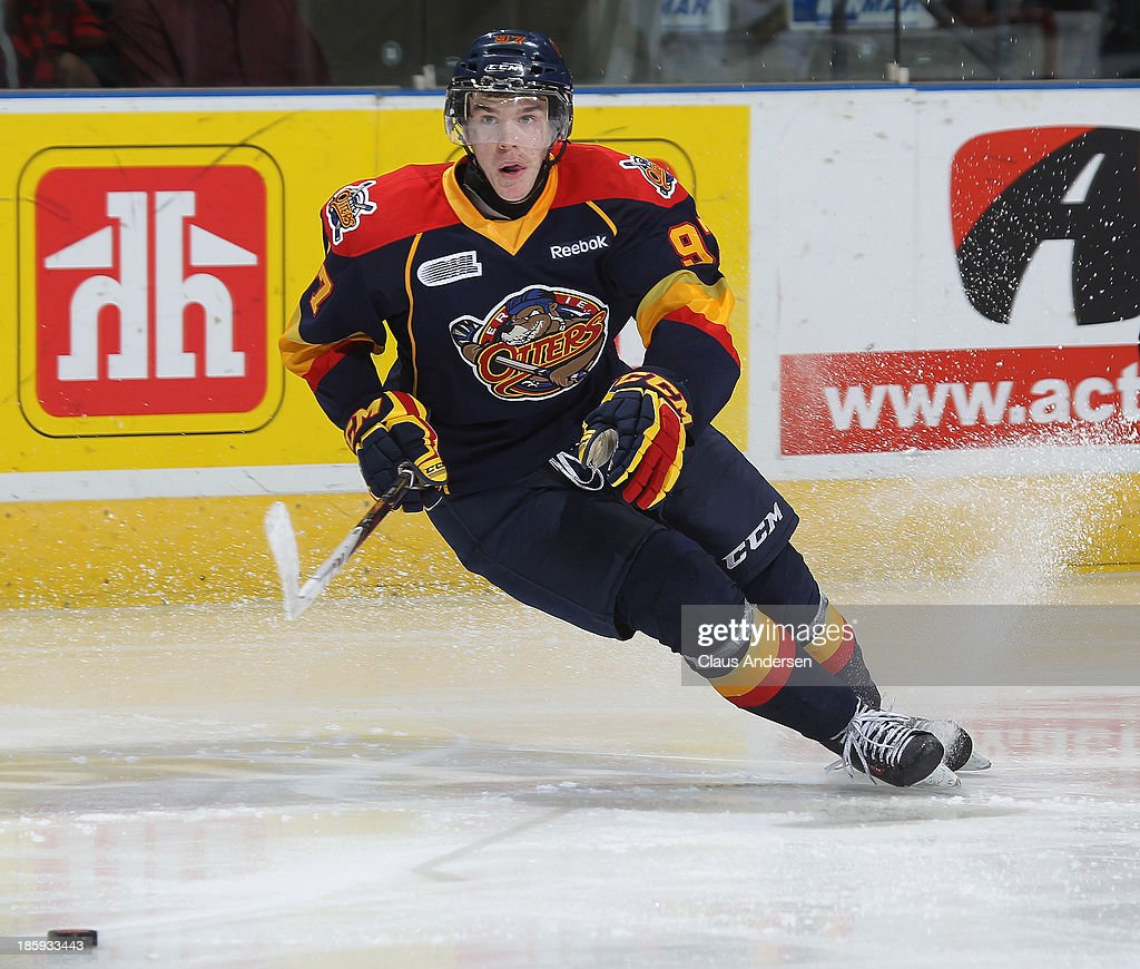 Connor McDavid #97 of the Erie Otters skates after the loose puck against the London Knights during an OHL game at the Budweiser Gardens on October 25, 2013 in London, Ontario, Canada. The Otters defeated the Knights 5-1.