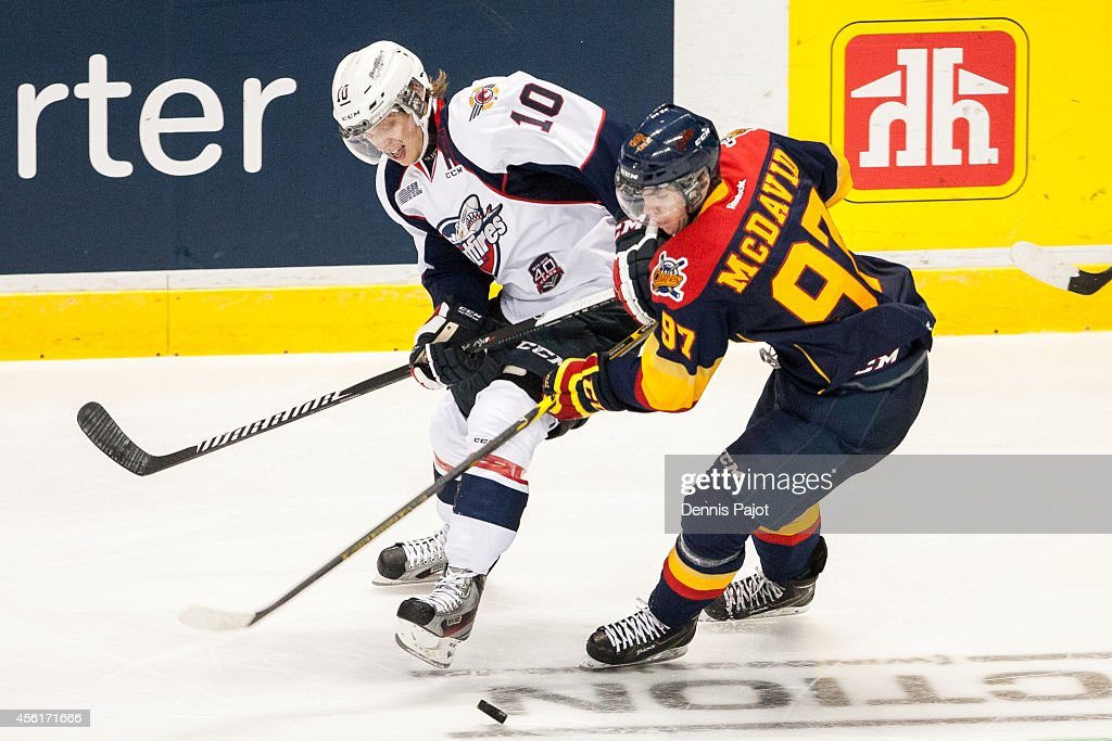 Connor McDavid #97 of the Erie Ottersbattles for the puck against Markus Soberg #10 of the Windsor Spitfires on September 26, 2014 at the WFCU Centre in Windsor, Ontario, Canada.