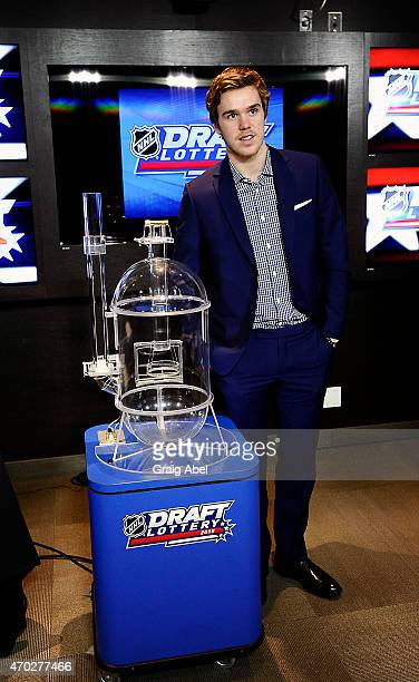 Connor McDavid poses in front of the lottery machine prior to the start of the National Hockey League Draft Lottery on April 18 2015 at the Sportsnet...