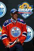 Connor McDavid poses on stage after being selected first overall by the Edmonton Oilers in the first round of the 2015 NHL Draft at BBT Center on...
