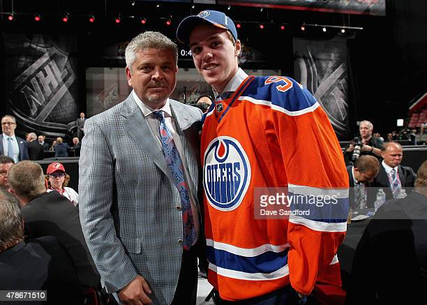 Connor McDavid poses with head coach Todd McLellan after being selected first overall by the Edmonton Oilers during Round One of the 2015 NHL Draft...