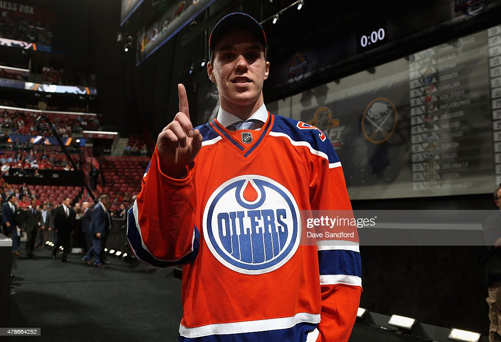 Connor McDavid signals number one after being selected first overall by the of the Edmonton Oilers during Round One of the 2015 NHL Draft at BB&T Center on June 26, 2015 in Sunrise, Florida.