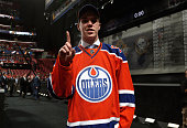 Connor McDavid signals number one after being selected first overall by the of the Edmonton Oilers during Round One of the 2015 NHL Draft at BBT...