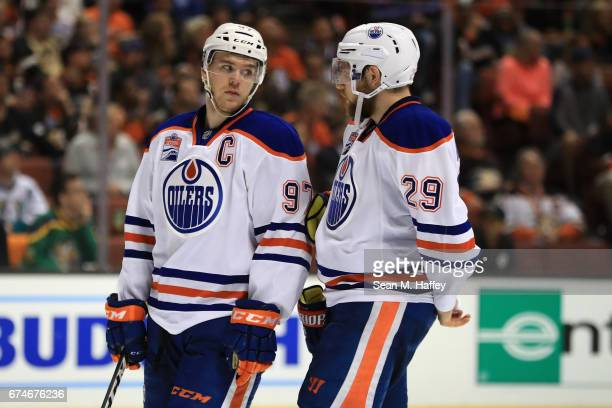 Connor McDavid talks with Leon Draisaitl of the Edmonton Oilers during the third period of Game Two of the Western Conference Second Round during the...