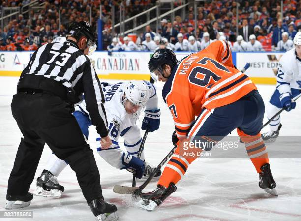 Connor McDavid#97 of the Edmonton Oilers takes a face off against Mitch Marner of the Toronto Maple Leafs on November 30 2017 at Rogers Place in...