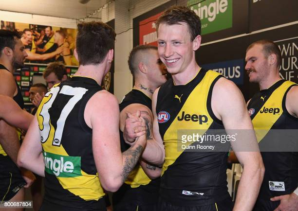 Connor Menadue and Dylan Grimes of the Tigers celebrate in the rooms after winning the round 14 AFL match between the Richmond Tigers and the Carlton...