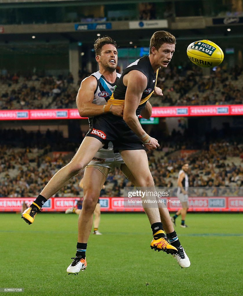 Connor Menadue of the Tigers and Travis Boak of the Power compete for the ball during the 2016 AFL Round 06 match between the Richmond Tigers and Port Adelaide Power at the Melbourne Cricket Ground on April 30, 2016 in Melbourne, Australia.